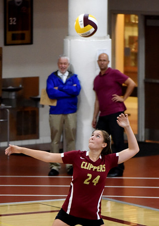 BRYAN EATON/Staff photo. Newburyport's #24 serves against North Reading.