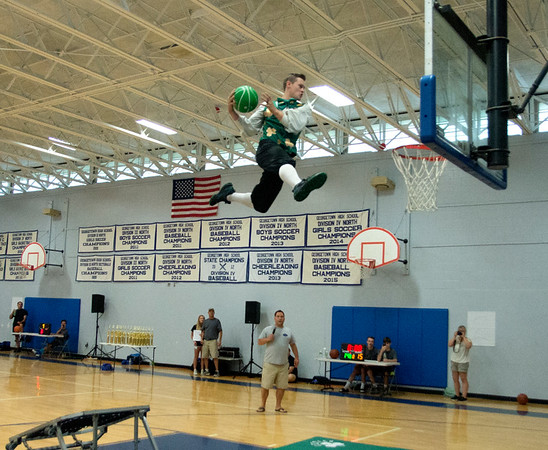JIM VAIKNORAS/Staff photo Celtics mascot Lucky the Leprechaun puts on a dunk show at the Cam Coye 3on3 basketball tournament at Georgetown High School Saturday.