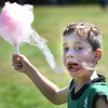 BRYAN EATON/Staff photo. Connor Lemieux, 8, of Amesbury does his best to corral some cotton candy that was blowing in the wind at the Boys and Girls Club year-end carnival on Thursday. They have the carnival on the second to last week of summer camp to include Newburyport members who go back to school next week.