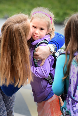 BRYAN EATON/Staff photo. Second-grader Libby Knapp, 7, gets a kiss from her mother, Katie, as she got dropped off at Newburyport's Bresnahan School for the first day of classes on Wednesday. Triton and Pentucket Regional School districts open next Tuesday, September 5.