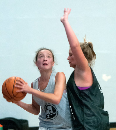 JIM VAIKNORAS/Staff photo Alana Olsen drives to the basket while guarded by Jenna Bard at the Cam Coye 3on3 basketball tournament at Georgetown High School Saturday.
