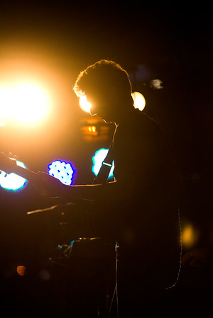 JIM VAIKNORAS/Staff photo Beatlejuice bassist Joe Holaday is silhouetted by stage lights during the bands performance Thursday night at Market Landing Park. The annual concert fills the Newburyport park with people dancing, and singing along to Beatles music.