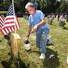 BRYAN EATON/Staff photo. Newburyport resident Larry Sostak has taken it upon himself to clean off the graves at the Veteran's Cemetery at Pond Street in Newburyport with permission of the city.