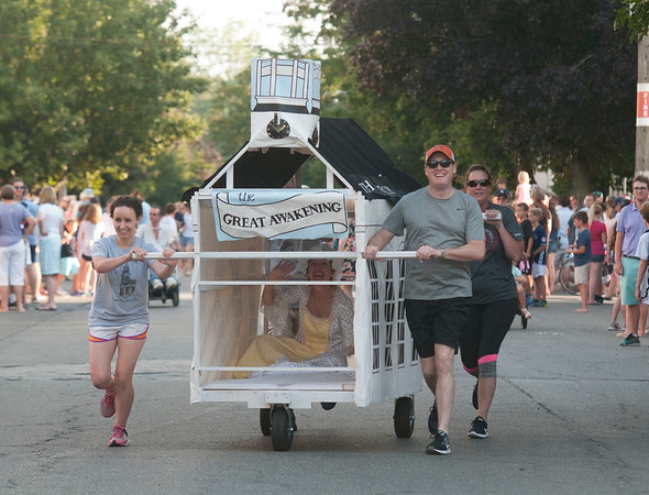 JIM VAIKNORAS/Staff photo One of 2 beds from the Old South Church in the Lions Club Bed Race on Federal Street in Newburyport Thursday night.