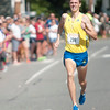 JIM VAIKNORAS/Staff photo High Street Mile Men's race winner Daniel Winn head to the finish line Sunday morning in front of Newburyport High School.