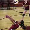 BRYAN EATON/Staff photo. Newburyport's #19 connects with the ball.