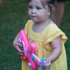 JIM VAIKNORAS/Staff photo Gabriela Meyers, 2, of Rowley strums along with Eagles cover band Dark Desert Eagles Saturday night at Market Landing Park in Newburyport.