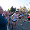 JIM VAIKNORAS/Staff photo  Speaker of the House Robert DeLeo cheers the start at the Newburyport Lions Club 10 mile race Tuesday night. His son Robbie was running.