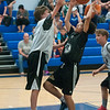 JIM VAIKNORAS/Staff photo Jason Silverio of Water fouls Marcus Avery of Stay in Yo Lane,  at the Cam Coye 3on3 basketball tournament at Georgetown High School Saturday.