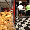 BRYAN EATON/Staff photo. The crew at Abraham's pumped out a lot of bagels on their opening day.