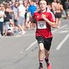 JIM VAIKNORAS/Staff photo High Street Mile Kid's race winner Will Coogan sprints to the finish Sunday morning in front of Newburyport High School.