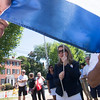 JIM VAIKNORAS/Staff photo   General Chairman Robin Johnson raises the Yankee Homecoming flag at Old Fashioned Sunday on Mall in Newburyport Sunday.