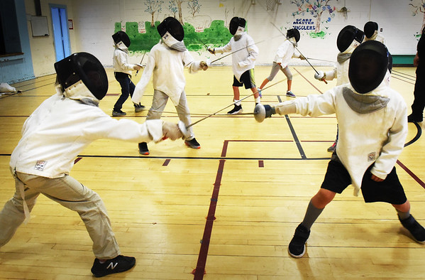 BRYAN EATON/Staff photo. Jack Mullarkey of 3MB Fencing Club brought the sport of fencing to the Newburyort Youth Services Summer program this week at the Brown School gymnasium. Monday the youngsters learned about the equipment involved, and Tuesday they learned basic moves as lunging.