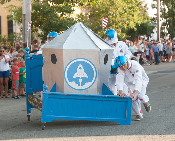JIM VAIKNORAS/Staff photo The bed from Rocket Insight lost a wheel on reentry during the Lions Club Bed Race on Federal Street in Newburyport Thursday night.
