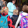 BRYAN EATON/Staff photo. Bresnahan School principal Kristina Davis greeted students as classes started in Newburyport on Wednesday.