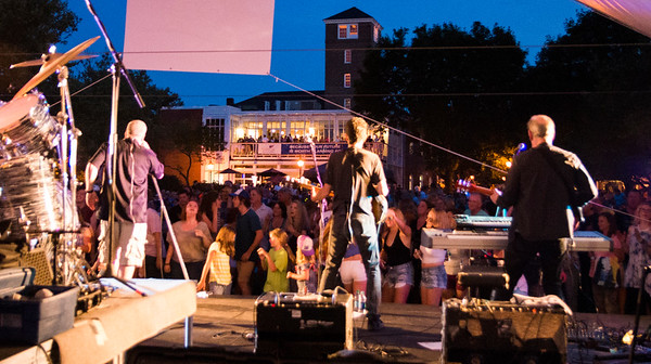 JIM VAIKNORAS/Staff photo Beatlejuice performs Thursday night at Market Landing Park. The annual concert fills the Newburyport park with people dancing, and singing along to Beatle music.