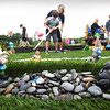 BRYAN EATON/Staff photo. Gnomes and other lawn decorations cover the miniature golf course built by special education students at Triton High School. The base of the course was leftover synthetic turf from the recent renovations of the stadium.