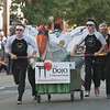 JIM VAIKNORAS/Staff photo The bed from The Dojo in Salisbury compete in the Lions Club Bed Race on Federal Street in Newburyport Thursday night.