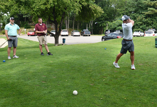 BRYAN EATON/Staff photo. Jeff Puopolo tees off at Old Newbury Country Club in the Paul Reilly Golf Tournament which raises money for the Newburyport High School Sports Hall of Fame.