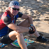 JIM VAIKNORAS/Staff photo Ron Dienstmann  ltakes a rest on the beach on Plum Island as he completes a cross country bike trip having left Portland Oregon on June 24th.