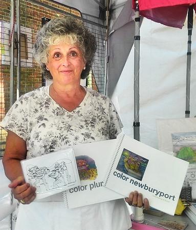 JIM SULLIVAN/Staff photo. Sandra Turner of Plumislander Art & Design at the Inn Street Artisans Revival.