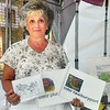 JIM SULLIVAN/Staff photo. Sandra Turner of Plumislander Art & Design at the Inn Street Artisans Revival.