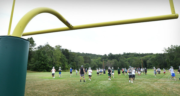 BRYAN EATON/Staff photo. Pentucket High School football players began practice for this season on Friday.