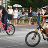 BRYAN EATON/Staff photo. Alex Dardinski, left, and Peter Martone brought the Slow Bike Race to a new level as they seemed to defy gravity in which was the longest heat so far since the event began several years ago. Martone when on to win in the final in the event sponsored by Coastal Trails Coalition.