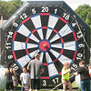 JIM VAIKNORAS/Staff photo Kids and adults kick Velcro soccer balls a a giant target at Merrimac Old Home Day at the Donahue School Saturday morning. The all day event included, face painting, a mechanical bull, strawberry shortcake, a bike parade, a road race, and much more.