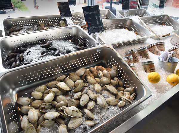 BRYAN EATON/Staff photo. Soft and hard shell clams, mussels and several types of oysters on ice at the new Newburyport Fish Market.