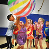 BRYAN EATON/Staff photo. Youngsters at the Boys and Girls Club in Salisbury play a game of giant volleyball on Friday afternoon as activities were moved indoors due to the rain. The club's summer program is open two more weeks, then will close a week and reopen on September 11 for afterschool programs.