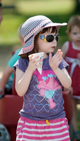 JIM VAIKNORAS/Staff photo Evangeline Marshall, 4, of Swampscott claps as she enjoys a snow cone   at this year's Yankee Homecoming  parade Sunday on High Street.