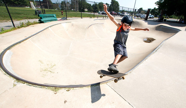 JIM VAIKNORAS/Staff photo Dominick Weinberger, 9, catches some air at the skate board park behind Nock Middle School Tuesday afternoon.Dominick has been boarding for about a year.