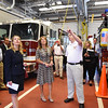BRYAN EATON/Staff photo. Lt. Gov. Polito, center, joined Department of Energy Resources Commissioner Judith Judson, Rep. Leonard Mirra and state and local officials to tour West Newbury's Public Safety Facility and learn about the projects made possible as part of the town's participation in the Department of Energy Resources Green Communities Program. West Newbury has received a total of $274,054 to fund clean energy and energy efficiency projects in town facilities. Here, volunteer fire chief Michael Dwyer shows flourescent lights that are yet to be converted to LED.