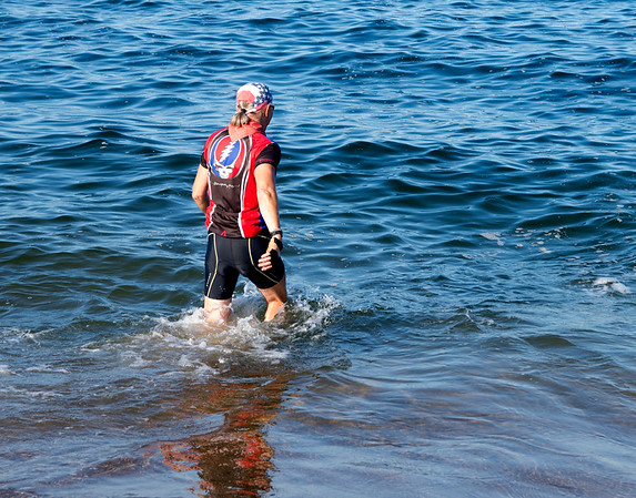 JIM VAIKNORAS/Staff photo Ron Dienstmann swims in the ocean  on Plum Island as he completes a cross country bike trip having left Portland Oregon on June 24th.