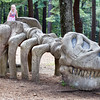 BRYAN EATON/Staff photo. Poplular with youngsters, like Kassidy Short, 4, of Amesbury, is this dinosaur skeleton replica at Moseley Woods in Newburyport.