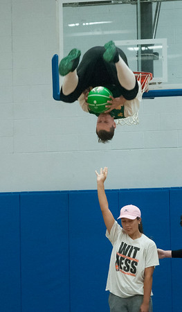 JIM VAIKNORAS/Staff photo Celtics mascot Lucky the Leprechaun does a 360 dunk after grabbing the<br /> basketball from Jada Burdier at the Cam Coye 3on3 basketball tournament at Georgetown High School Saturday.