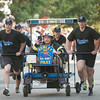 JIM VAIKNORAS/Staff photo The Rowley Police compete in the Lions Club Bed Race on Federal Street in Newburyport Thursday night.