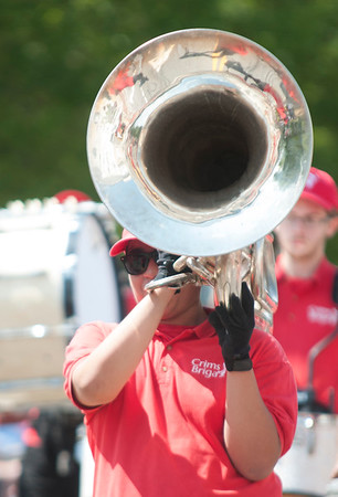 JIM VAIKNORAS/Staff photo Chris Moralas plays tuba with the Crimson Brigade from Plymouth in this year's Yankee Homecoming  parade Sunday on High Street.