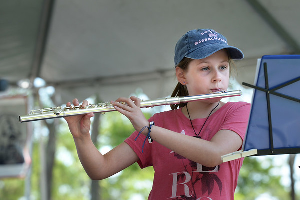 "BRYAN EATON/Staff photo. Lauren Konefal, 12, of Connecticut, here on vacation with her family, played the flute in the Kids Talent Showcase performing ""Drunken Sailor,"" the Marine Corps Hymn and the theme song from the television show ""The Brady Bunch."""