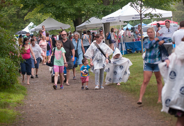 JIM VAIKNORAS/Staff photo Rain showers didn't stop people from enjoying Family Day at Maudslay Saturday morning.