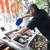 BRYAN EATON/Staff photo. Owner Fred Derr ices down soft and hard shell clams, mussels and several types of oysters at the Newburyport Fish Market.