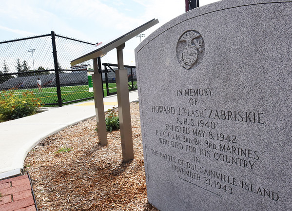 "BRYAN EATON/Staff photo. A memorial to Howard J. ""Flash"" Zabriskie, who stood in sports at Newburyport High School and who died in the Pacific Theater in World War II, is at the entrance to World War Memorial Stadium."