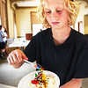 "BRYAN EATON/Staff photo. Luke MacIsaac, 8, of Newburyport piles on the confections at a ""Build a Better Sundae"" at the Newburyport Public Library on Monday afternoon. They were celebrating the last week of summer reading"