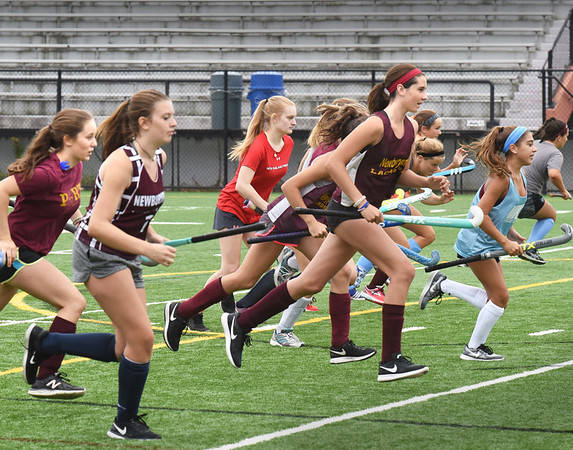 BRYAN EATON/Staff photo. Newburyport field hockey team run drills.