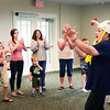 BRYAN EATON/Staff photo. Singer and musician Nancy Sweeney of Salisbury leads youngsters into song and dance at the Salisbury Public Library on Monday morning. It was the last day of the summer reading program and the children were celebrating.