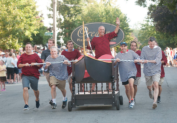 JIM VAIKNORAS/Staff photo Oregano's of Newburyport used a gondola bed in the Lions Club Bed Race on Federal Street in Newburyport Thursday night.