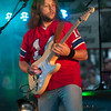 JIM VAIKNORAS/Staff photo Triton graduate Eric Clemenzi wears a Steve Grogan shirt as he plays with Eagles cover band Dark Desert Eagles Saturday night at Market Landing Park in Newburyport.