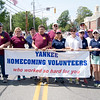 JIM VAIKNORAS/Staff photo A group of Yankee Homecoming volunteer march together at the end of the annual Newburyport festival's parade Sunday on High Sctreet