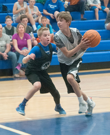 JIM VAIKNORAS/Staff photo Kyle Salvo of Water drives on Preston Archer of Stay in Yo Lane,  at the Cam Coye 3on3 basketball tournament at Georgetown High School Saturday.